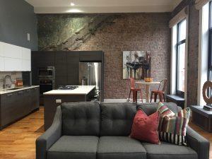 Louisville Interior Designer, Louisville Renovation Designer, Louisville Home Staging, Urban Loft, Industrial Loft, Exposed Brick, Hardwood Flooring, Modern Decor, Views of Downtown, Falls City Condo, Cool Color Scheme, Staging Sells