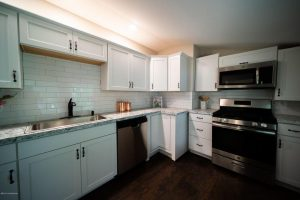 Louisville KY Home Staging, Louisville KY Interior Design, Louisville KY Renovation, Shotgun Home Stage, Sold in less than a month, light walls, stainless appliances, light linens, lighter colors make rooms look more spacious, hardwood flooring
