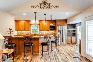 Louisville, Ky Home Staging, Louisville, KY Interior Design, Louisville, KY Home Renovation, Hardwood Flooring, Kitchen Island, Kitchen Backsplash, Stainless Appliances, Kitchen Island Lighting