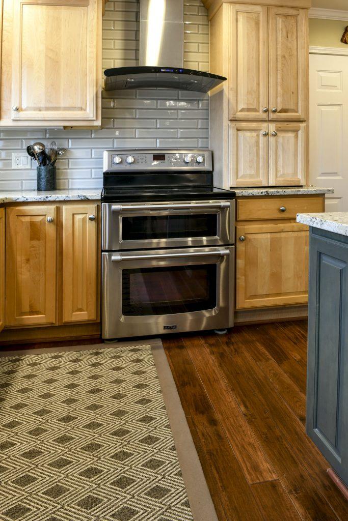 Louisville Kentucky Home Renovation, Kitchen Renovation, Hand Scraped Hickory Floor, Granite Counter Tops, Brushed Nickel Fixtures, Area Rug, Stainless Steel Appliances, Kitchen Island