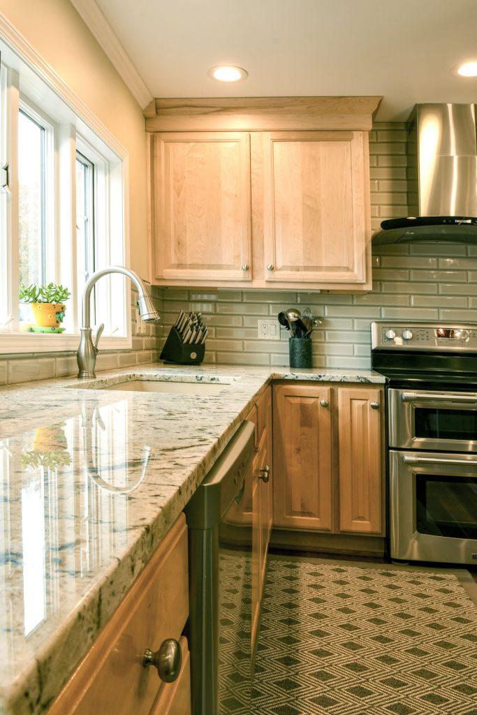 Louisville Kentucky Home Renovation, Kitchen Renovation, Hand Scraped Hickory Floor, Granite Counter Tops, Brushed Nickel Fixtures, Area Rug, Stainless Steel Appliances
