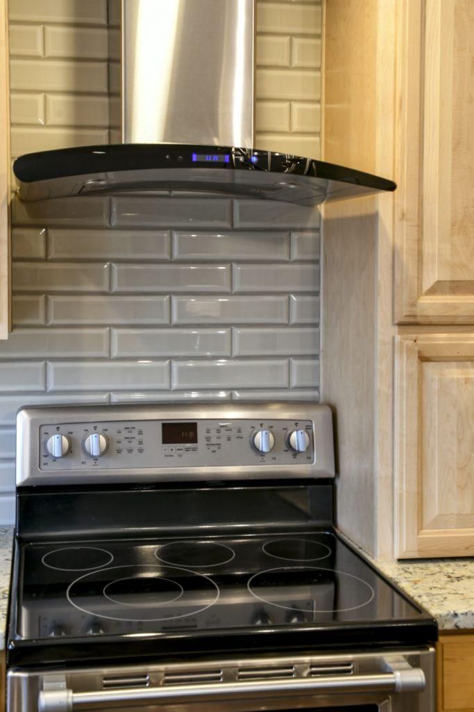 Louisville Kentucky Home Renovation, Kitchen Renovation, Stainless Hood, Stainless Steel Appliances, Tile Back Splash, Granite Countertops