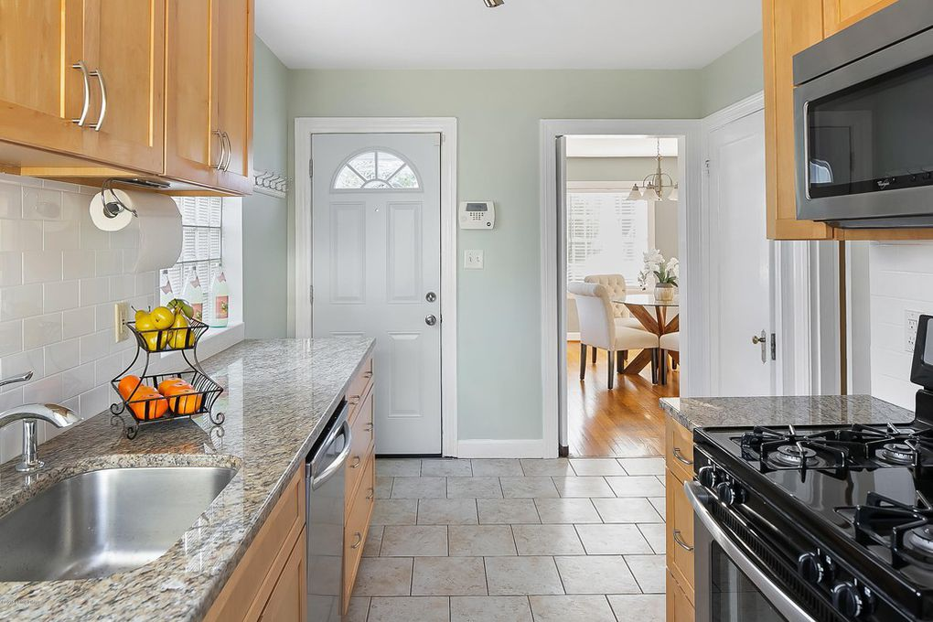 Louisville Kentucky Home Staging, Galley Kitchen, Granite Countertops, Tile Flooring, Stainless and Black Gas Range, Stainless Steel Appliances, Subway Tile, Chrome Fixtures