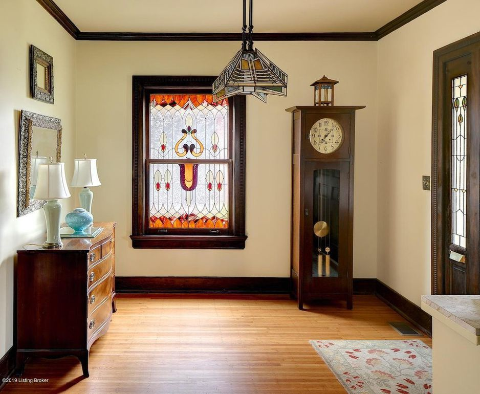 stained glass window, grandfather clock, honey oak hard wood floors, stained glass light fixture