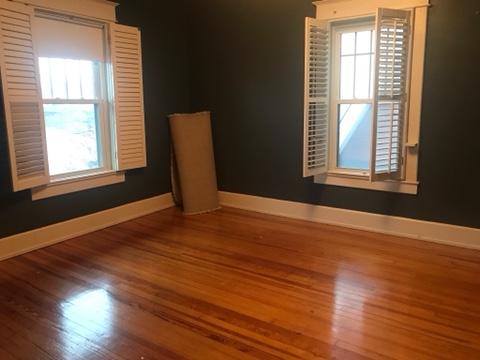 empty bedroom, small bedroom, hardwood floors, dark blue wall paint, plantation shutters
